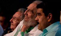 Former Cuban leader Fidel Castro (C), Cuba's President Raul Castro (L) and Venezuela's President Nicolas Maduro attend a gala for Fidel Castro's 90th birthday at the Karl Marx theatre in Havana, Cuba