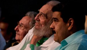 Former Cuban leader Fidel Castro (C), Cuba's President Raul Castro (L) and Venezuela's President Nicolas Maduro attend a gala for Fidel Castro's 90th birthday at the Karl Marx theatre in Havana, Cuba
